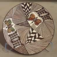 Butterfly, fine line and geometric design on a polychrome plate