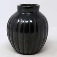 A carved black melon jar