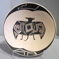 Mimbres bat and geometric design on a black on tan plate