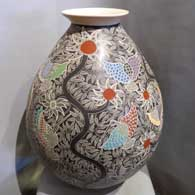 Sgraffito and painted hummingbird, branch and flower design on a large polychrome jar