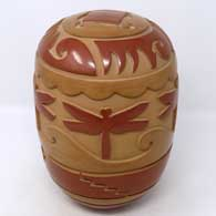 Red and brown seed pot carved with kiva step, dragonfly and geometric design