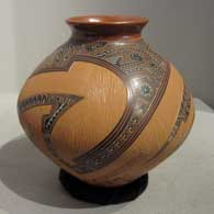 Carved, sgraffito and painted shard and geometric design on a brown jar