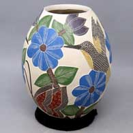 Polychrome jar with sgraffito and painted bird, butterfly, flower and branch design