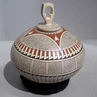 Geometric design plus sculpted lid with geometric design on a polychrome jar