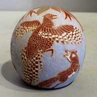 Sgraffito nature design on a polychrome seed pot by Camilio Tafoya