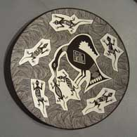 Black and white plate with Mimbres designs by Carolyn Concho