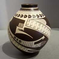 Free-flowing Paquime geometric design painted on a brown and white jar