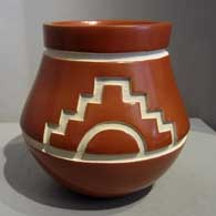Carved red jar with sun and kiva step design
