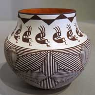 Black and white fine line, kokopelli and geometric design on a polychrome pot