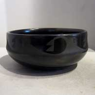 Geometric design on a black on black bowl