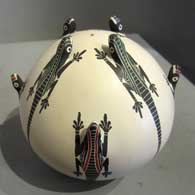 Lizard motif on a polychrome seedpot