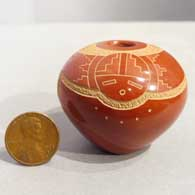 Sgraffito katsina and geometric design on a red seed pot