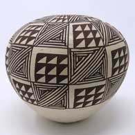 Fine line and slanted mesa design on a black and white seed pot