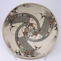 Bird element, fish and geometric design on a polychrome bowl