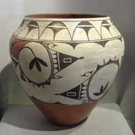 Traditional geometric design on a large polychrome storage jar, by Helen Gachupin