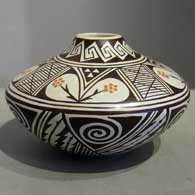 Awatovi spiral, lightning, medium shard and geometric design on a polychrome seed jar