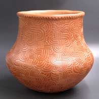 Brown jar decorated with a paddle-stamped geometric design