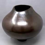 Plain polished brown jar with an organic opening