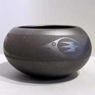 An avanyu design on a micaceous black jar by Johnny Cruz