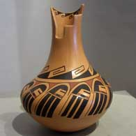 Geometric and long-haired katsina design on a polychrome jar