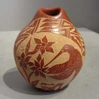 Sgraffito design on a red seedpot