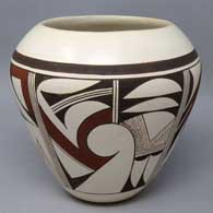 White ware jar with bird element and geometric design, made by Marianne Navasie
