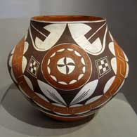 Rainbow, medallion and geometric design on a polychrome jar