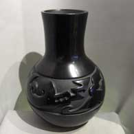 Mela Youngblood carved an avanyu design into this black jar