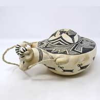 Black and white canteen with sculpted bighorn ram handle and painted Mimbres ram and geometric design
