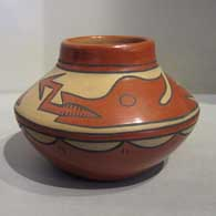 Minnie Vigil of Santa Clara Pueblo created this polychrome jar with an avanyu and rain cloud design