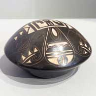 Sgraffito geometric design on a black and white seed pot