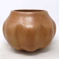 A formed, not carved, golden micaceous melon shaped jar
