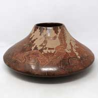 Sgraffito wildlife and nature design on a bownware jar