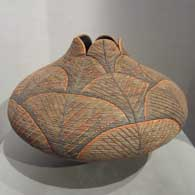 Textured polychrome jar with an organic opening
