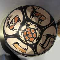 Wildlife and geometric design on a polychrome bowl