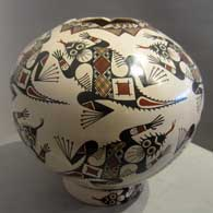 Stylized Mimbres horned toads, geometric design and a hexagonal opening on a brown jar