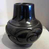 Black jar carved with avanyu design