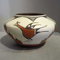 Roadrunner, rain, cloud and geometric design on a polychrome jar, by Sofia Medina