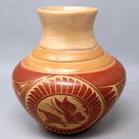 Polychrome jar with sgraffito medallion, flower, butterfly and geometric design