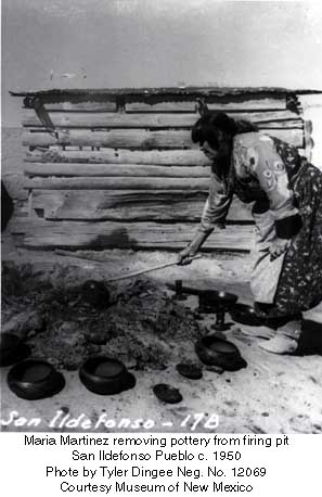 Maria Martinez removing pottery from firing pit San Ildefonso Pueblo c. 1950 Phote by Tyler Dingee Neg. No. 12069 Courtesy Museum of New Mexico