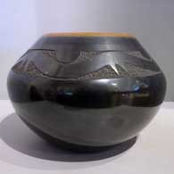 Black jar with sienna rim and sgraffito avanyu with an inlaid stone Last month , click or tap to see a larger version