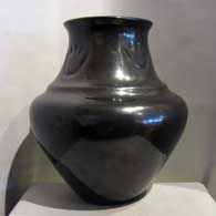 Polished large black double-shouldered jar with bear paw imprints  , click or tap to see a larger version