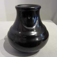 Polished black double-shoulder jar with two bear paw imprints  , Click or tap to see a larger version