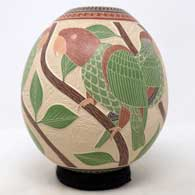 Polychrome jar with sgraffito and painted parrot, branch and geometric design , click or tap to see a larger version