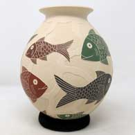 Polychrome jar with sgraffito and painted fish and geometric design , click or tap to see a larger version