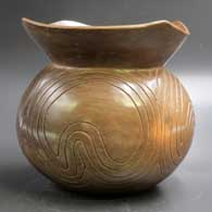 Brown jar with a crowned rim and carved geometric design, click or tap to see a larger version