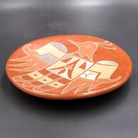 Polychrome plate with a thunderbird and geometric design, click or tap to see a larger version