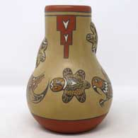 Polychrome jar with fantastical creatures and geometric design , click or tap to see a larger version