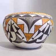 Polychrome jar with pie crust rim and geometric design New Arrival this month , click or tap to see a larger version