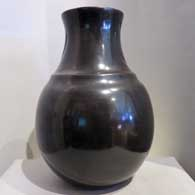 Double-shouldered black jar with bear paw imprints   , click or tap to see a larger version